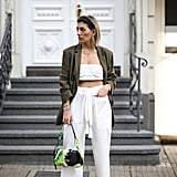 Style a white crop top with matching pants and a green blazer.
