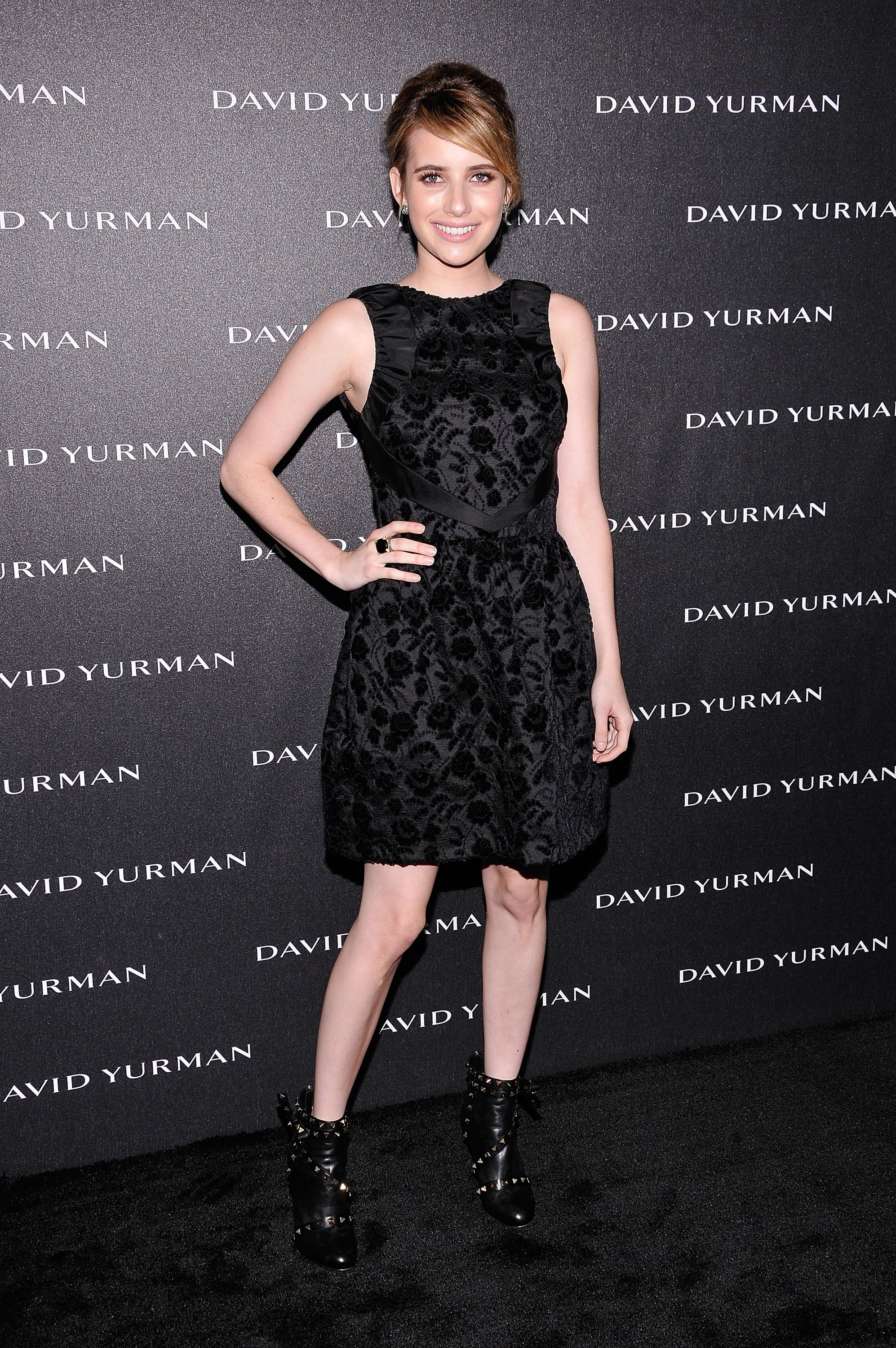 Emma kept things cool and simple in a black jacquard dress with studded Valentino booties for a David Yurman event in May 2012.
