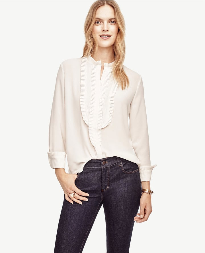 """Ruffles, frills, feminine details — I'm honestly loving it all. And while I know Ann Taylor's Pleated Blouse ($90) will be as versatile as any white shirt, that bib detail makes it seem all the more special."" — SS"