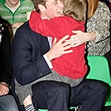 During a January 2010 visit to the Eresby School in England, Prince William was embraced by a little boy name Darren Pearty. Check out that bear hug!