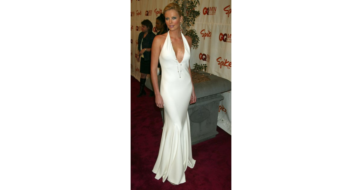 Charlize looked white hot in a cleavage-baring Ralph Lauren gown at ...