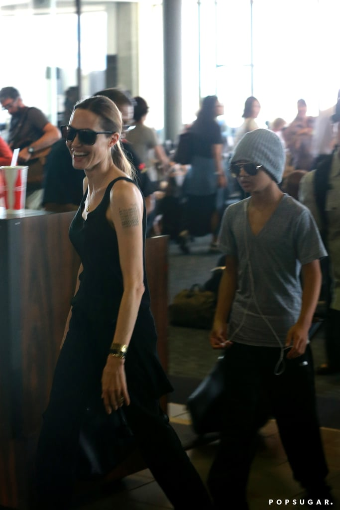 Angelina Jolie smiled as she touched down in Hawaii with Maddox Jolie-Pitt.