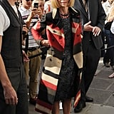 Anna Wintour attended a photocall for the official store opening of Rag & Bone on day two of LFW, opting for the label's Southwest-inspired coat to top her signature look.