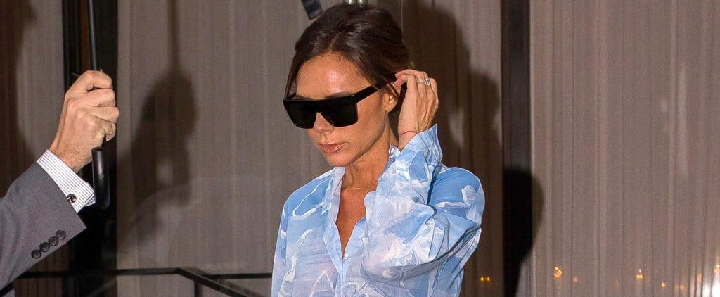 Victoria Beckham Wearing Blue Top and Skirt