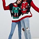 ASOS Boohoo Santa and Elf Two-Person Holiday Sweater ($44)