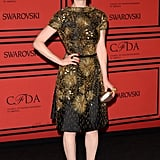 Ellie Kemper dazzled in a gold embellished fit-and-flare dress and gold strappy Rupert Sanderson sandals.