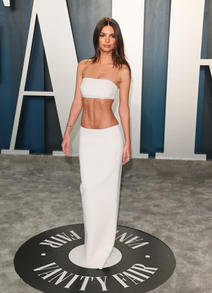 Emily Ratajkowski arrived at the Vanity Fair Oscars afterparty in the sleekest two-piece look you could possibly imagine. The matching white cropped tube top and column skirt were simple yet made a major statement. She complemented her look with a silver cuff bracelet and twinkling rings. The effortless ensemble took us back to the classic supermodel aesthetic from the '90s. We're so into it! Make sure to check out every angle of this matching set. BRB, shopping for a white slip skirt.      Related:                                                                                                           Martha Stewart Is Wearing a Sexy LBD to the Vanity Fair Oscars Party Like It's Her Freakin' Job