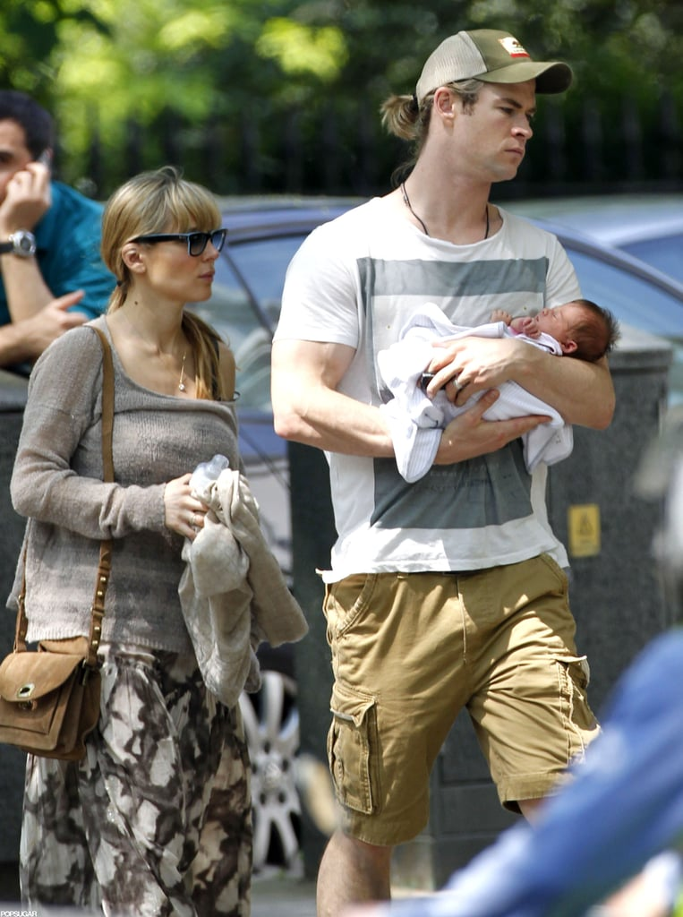 Chris Hemsworth and Elsa Pataky took daughter India Rose out in London earlier this week. Chris held his baby girl in his arms while Elsa followed closely behind carrying a blanket and a bottle. India was born just three weeks ago, but she's already been out and about. Chris and Elsa debuted India earlier this month, after Chris wrapped up his portion of early promotions for Snow White and the Huntsman.  He became a dad in the middle of a busy press schedule, and took a break to spend time with his new family while his costars Kristen Stewart and Charlize Theron continued making appearances to chat up the project. Chris is back on the go, and popped up in NYC this afternoon for a visit to Live With Kelly that will air tomorrow morning. SWATH hits theaters tomorrow, though Chris already has a hit at the box office. The Avengers had a huge opening and stayed on top for three weeks until Men in Black 3 finally defeated the superhero movie in ticket sales last weekend.