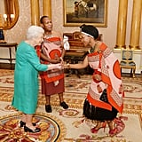 Queen Elizabeth II greeted Mrs. Nkambule, the wife of Mr. Christian Muzie Nkambule the High Commissioner of Swaziland, after he presented his Letters of Credence at the Buckingham Palace.