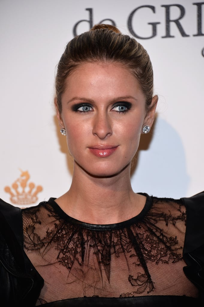 Nicky kept her look understated, completing her LBD with sparkly studs and a swept-back bun.