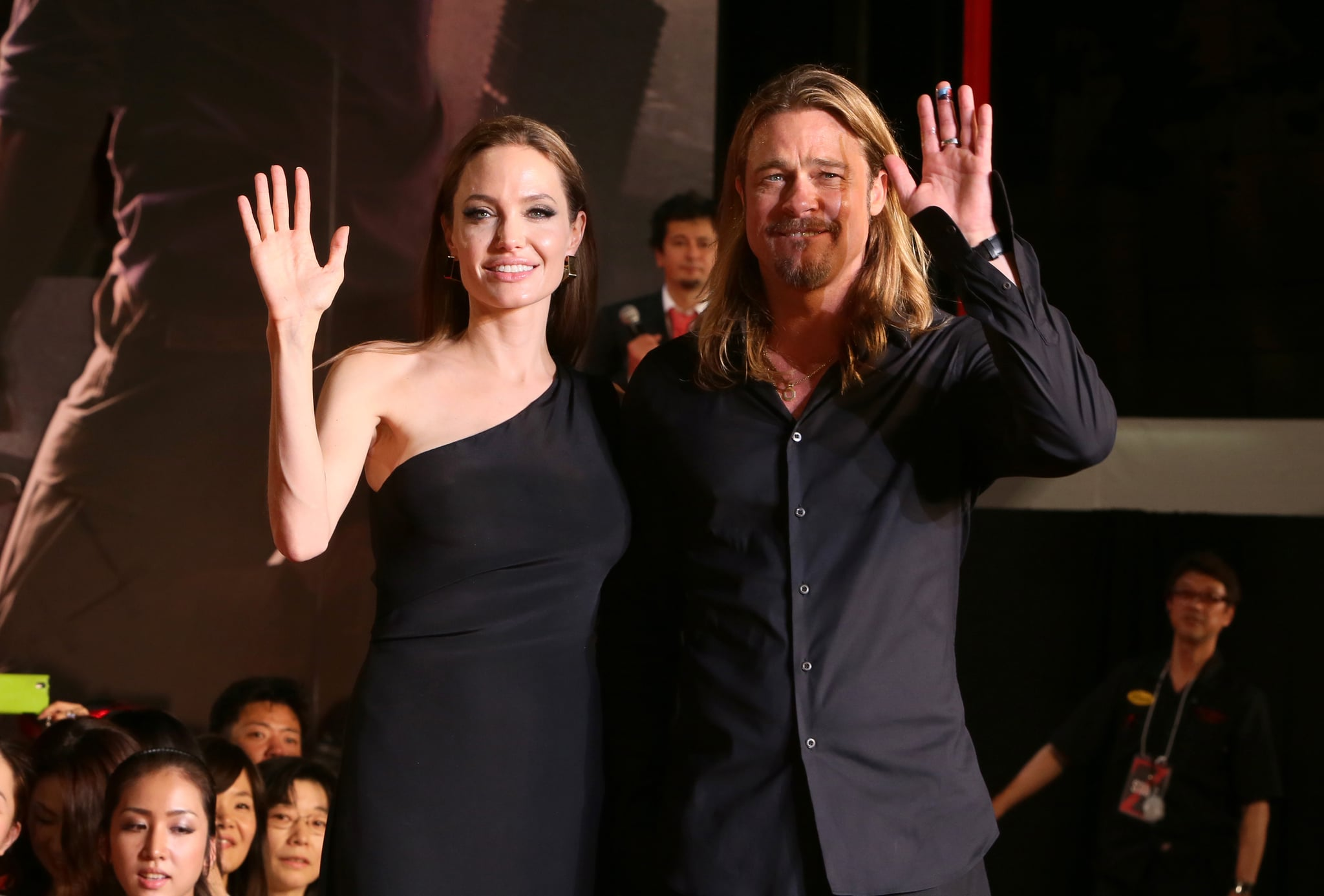 Brad Pitt and Saint Laurent-clad Angelina Jolie gave a wave to the crowd during the premiere of World War Z in Tokyo.
