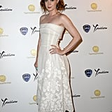 Amy Adams accentuated her white strapless lace Dolce & Gabbana dress with orange Rupert Sanderson pumps and turquoise earrings at the Taormina Film Fest in Italy.