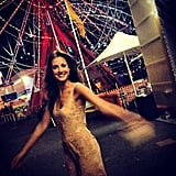 Laura Dundovic looked glamorous as she took a nighttime stroll through Sydney's Luna Park.