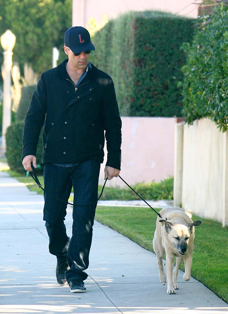 Jon Hamm took his dog for a neighborhood walk in LA in December 2011.