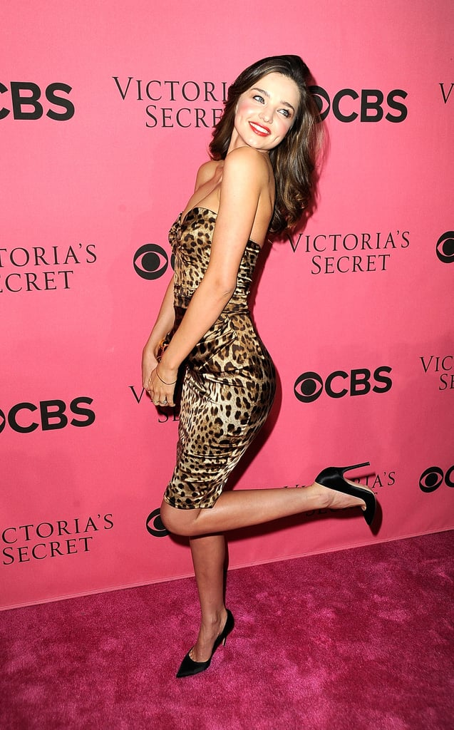 Miranda Kerr kicked up her heels on the pink carpet for the Victoria's Secret Fashion Show viewing party.