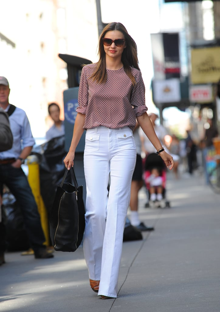 Miranda Kerr hit the pavement in the Big Apple yesterday in white pants and a printed top. She was solo to run errands, but is in the Big Apple with her husband, Orlando Bloom, who's relaxing and enjoying motorcycle rides around the city. He has some time off to focus on family after being on the set of The Hobbit: An Unexpected Journey and before the release of his next movie, The Good Doctor, on Aug. 31. The happy couple has made time for each other — Miranda and Orlando were hand in hand for a loving stroll and have also taken son Flynn Bloom out in the city. Miranda and Orlando have something to celebrate as well, since they both ranked in the 2012 PopSugar 100.