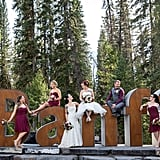 This Banff wedding featured bridesmaids in short wine-colored dresses.