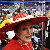 A female attendee wore a hat with an elephant on it inside the convention.