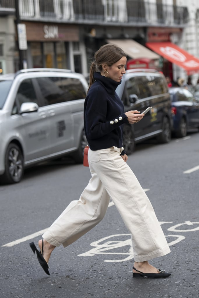 Warm up white jeans with a sweater and finish with pretty flats