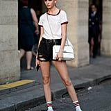 For retro-chic, team a ringer tee and tube socks with your denim shorts.