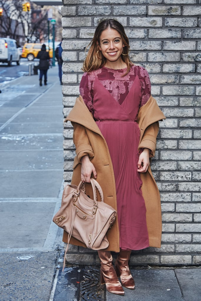 On Editor Sarah Wasilak: Aritzia blouse and dress, H&M Studio jacket, Balenciaga bag, Stuart Weitzman boots, and earrings editor's own