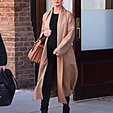 Rosie Huntington-Whiteley broke up her all-black outfit with a long, beige cardigan.
