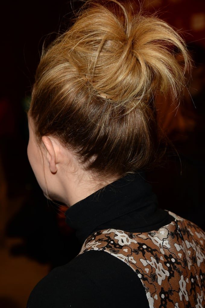 """""""For Chloë's look for the premiere, we wanted to do a textured, fashion-inspired topknot,"""" said Urban. """"I began by spraying her damp hair section by section with Leonor Greyl's Voluforme ($36) for volume and lift and then blew it dry with a large round brush. In one-inch sections, I backcombed all of her hair loosely and then gathered it into a high ponytail with my hands and secured with an elastic. I didn't want to brush the ponytail into place, because then I would lose the texture from the backcombing. I teased the pony, wrapped it into a bun, and secured with bobby pins and hair pins."""" And the most important part? """"I pulled the bun apart slightly and pulled out some wispy pieces around the hairline to give it a really loose, textured feel,"""" the beauty pro explained. """"To finish and set the look, I sprayed Chloë's hair with Leonor Greyl Spray Structure Naturelle ($38) for all-night hold."""" Hear that girls? So put down your bun roller and use the texture that you've got to create a mega bun. Second-day hair encouraged."""