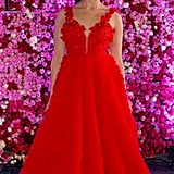 Looking ravishing in a flowy red gown.