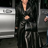 Wearing an Alaïa leather trench coat with a Céline bag.