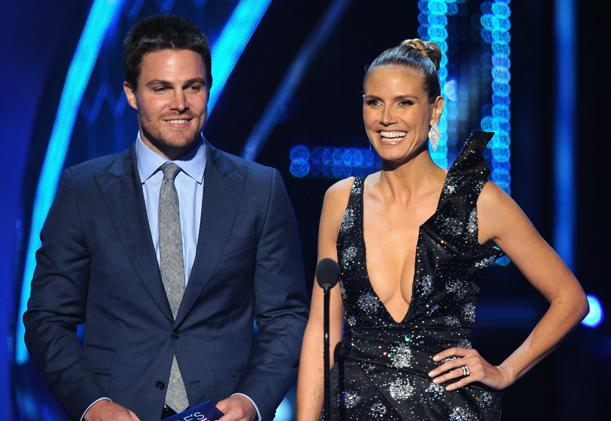 Heidi Klum and Stephen Amell joked around when they played presenters at the show.