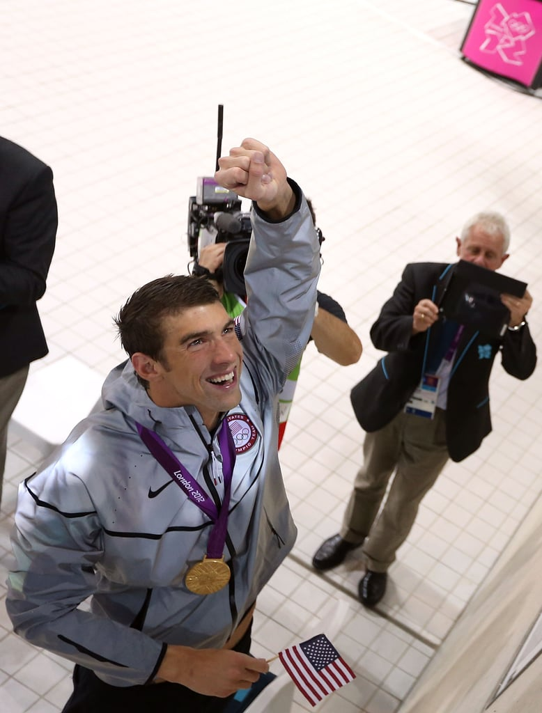 Michael Phelps took to the crowds after a record-setting win. After the relay win, Phelps went on to earn his 19th and 20th Olympic medals. He is now the most decorated Olympian in history!