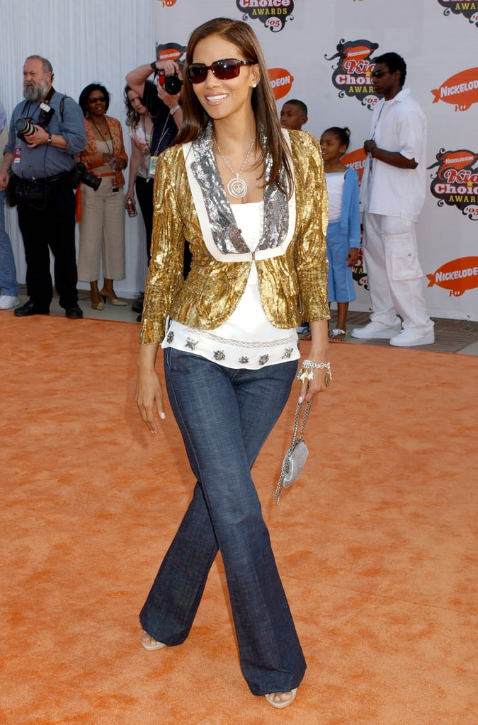 Halle Berry gave her denim look a gilded edge, thanks to a metallic cropped jacket, in 2005.