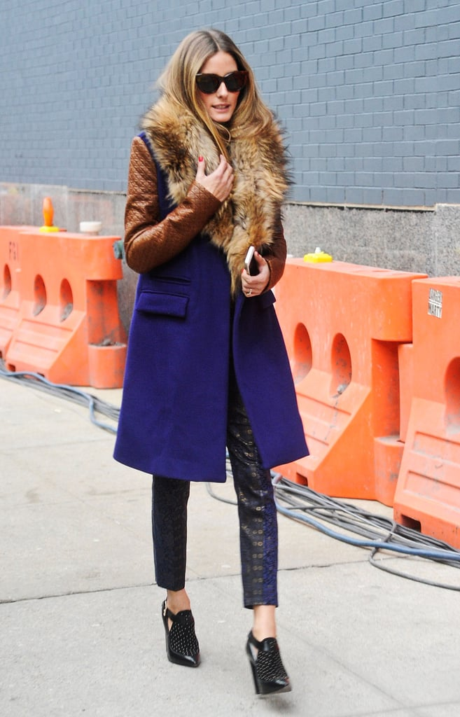 Olivia made the sidewalk her catwalk and stayed bundled up in a two-toned DVF coat, jacquard Tibi pants, and Rebecca Minkoff booties.
