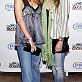 Sisters Ashley Olsen and Mary-Kate Olsen dressed down in their jeans for the grand opening of Fox Sports Grill in LA in June 2003.