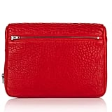 Made with that same distressed-meets-pebbled leather that we love so dearly in Rocco or Diego bag form, this chic red-hued Alexander Wang iPad case puts technology support to a sexy standard. Alexander Wang Fumo iPad in Cayenne Pebble Lamb With Black Nickel ($365)