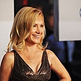 Angela Kinsey smiled in a metallic dress.