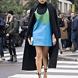 Tame a minidress with a turtleneck underneath.