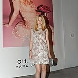 Dakota snapped a photo in front of her Marc Jacobs fragrance poster.