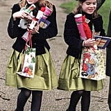 A young Princess Beatrice and her sister, Eugenie, carried handfuls of presents while heading to church on Christmas Day in 1997.