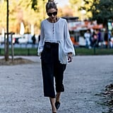 Hack: Half tuck a billowing top to attract all eyes to a paper-bag pant with a bow at the waist.