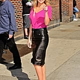 Kate Hudson wore a bright pink top and black leather skirt for her appearance on The Late Show in NYC.