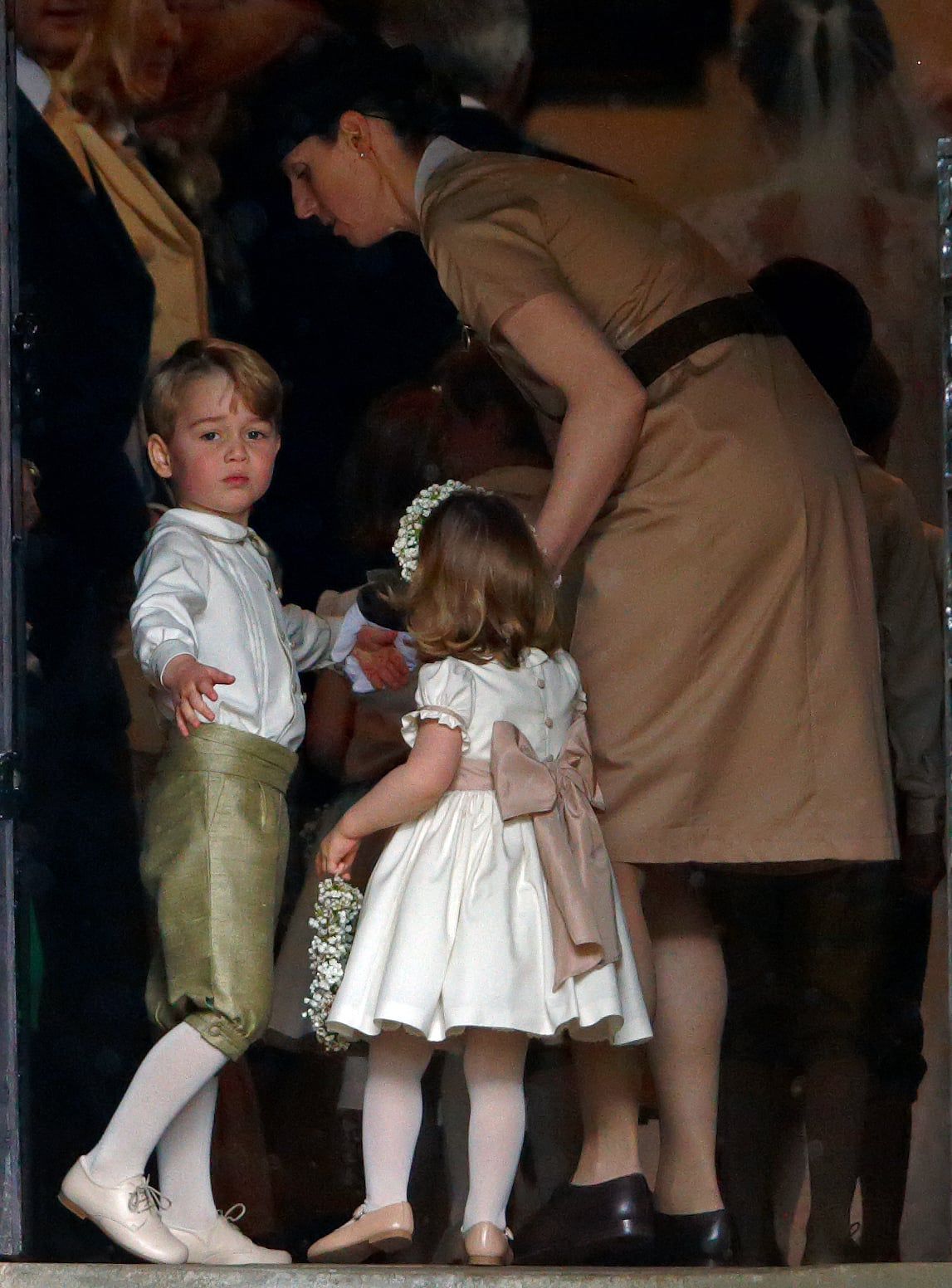 ENGLEFIELD GREEN, UNITED KINGDOM - MAY 20: (EMBARGOED FOR PUBLICATION IN UK NEWSPAPERS UNTIL 48 HOURS AFTER CREATE DATE AND TIME) Prince George of Cambridge and Princess Charlotte of Cambridge accompanied by their nanny Maria Teresa Borrallo attend the wedding of Pippa Middleton and James Matthews at St Mark's Church on May 20, 2017 in Englefield Green, England. (Photo by Max Mumby/Indigo/Getty Images)