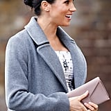 ‎Meghan Markle Carrying a Wilbur & Gussie Charlie Bespoke Silk Clutch Bag in Oyster