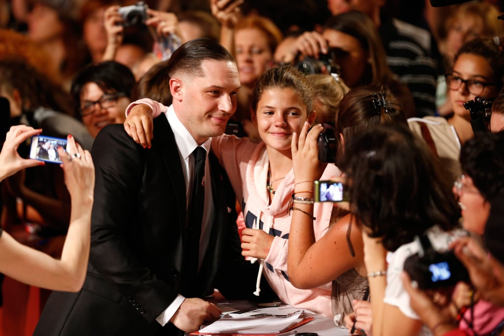 Tom Hardy snapped pictures with fans at the Locke premiere.