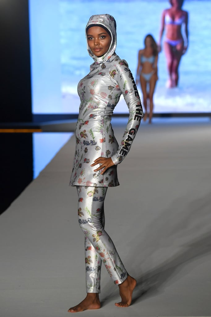 "Halima Aden made her way back to the runway this week to wow us all in a custom burkini and hijab for the Sports Illustrated 2019 show as part of Miami Swim Week. The 21-year-old Somali-American model kicked-off the publication's event in a metallic ensemble courtesy of Cynthia Rowley, that read ""Don't change yourself, change the game"" down the sleeves.  Earlier this year, Halima made Sports Illustrated history as the first woman to grace the magazine's pages in a hijab and burkini. She was also the first woman to wear a burkini in the Miss Minnesota USA pageant. ""Growing up in the United States, I never really felt represented, because I never could flip through a magazine and see a girl who was wearing a hijab,"" she said in a video, reflecting on her accomplishments.  Halima's taste in swimwear isn't the only thing worth applauding — her sophisticated street style is just as impressive. Keep reading to see more photos from her night on the runway, and then catch up on her other groundbreaking moments in fashion."