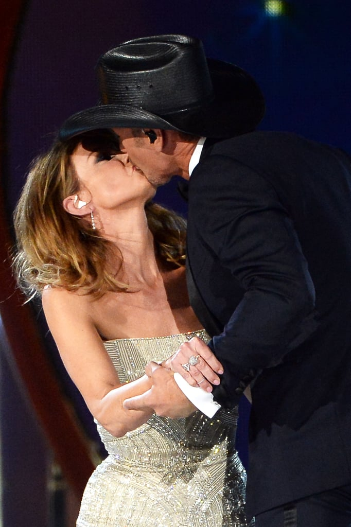 Faith Hill and her husband, Tim McGraw, shared a kiss after their performance.