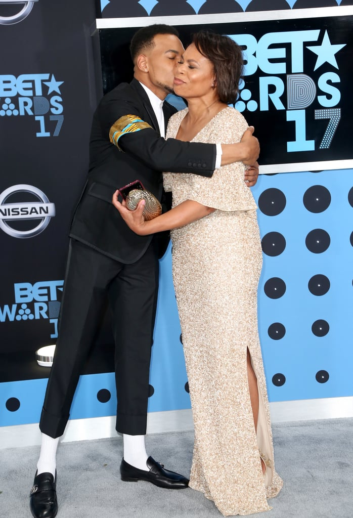 Chance the Rapper's first time at the BET Awards was truly a night to remember. In addition to channeling Michael Jackson in his black suit and matching armband, the 24-year-old musician had the support of his mom, Lisa Bennett, ahead of his big night. While there was no sign of his adorable daughter, Kensli, Chance made the most of the fun outing with his mom by hitting the red carpet together and giving each other kisses on the cheek in the audience. Chance was later honored with the humanitarian award for his recent philanthropic efforts and received a special message from none other than Michelle Obama.       Related:                                                                                                           Chance the Rapper Just Made History by Hiring ASL Interpreters For His Concert Tour