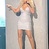 Christina Aguilera sang onstage in a white minidress.