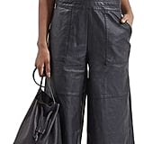 I'm still obsessed with the look of leather overalls, but between my newfound love of flares and the eerily warm temps in NYC, I can't bear to pull on pants that are tight around my ankles. Topshop's Faux Leather Culotte Overalls ($105) combine the best of both worlds, helping me nail this style in a way that's comfortable and cool.  — SS