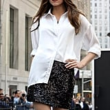 Crisp white shirt + sequin skirt = Fabulous. Love the half-tucked styling.